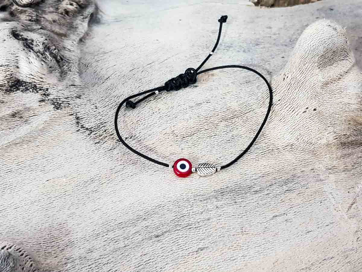 Red Evil Eye Leaf Black String