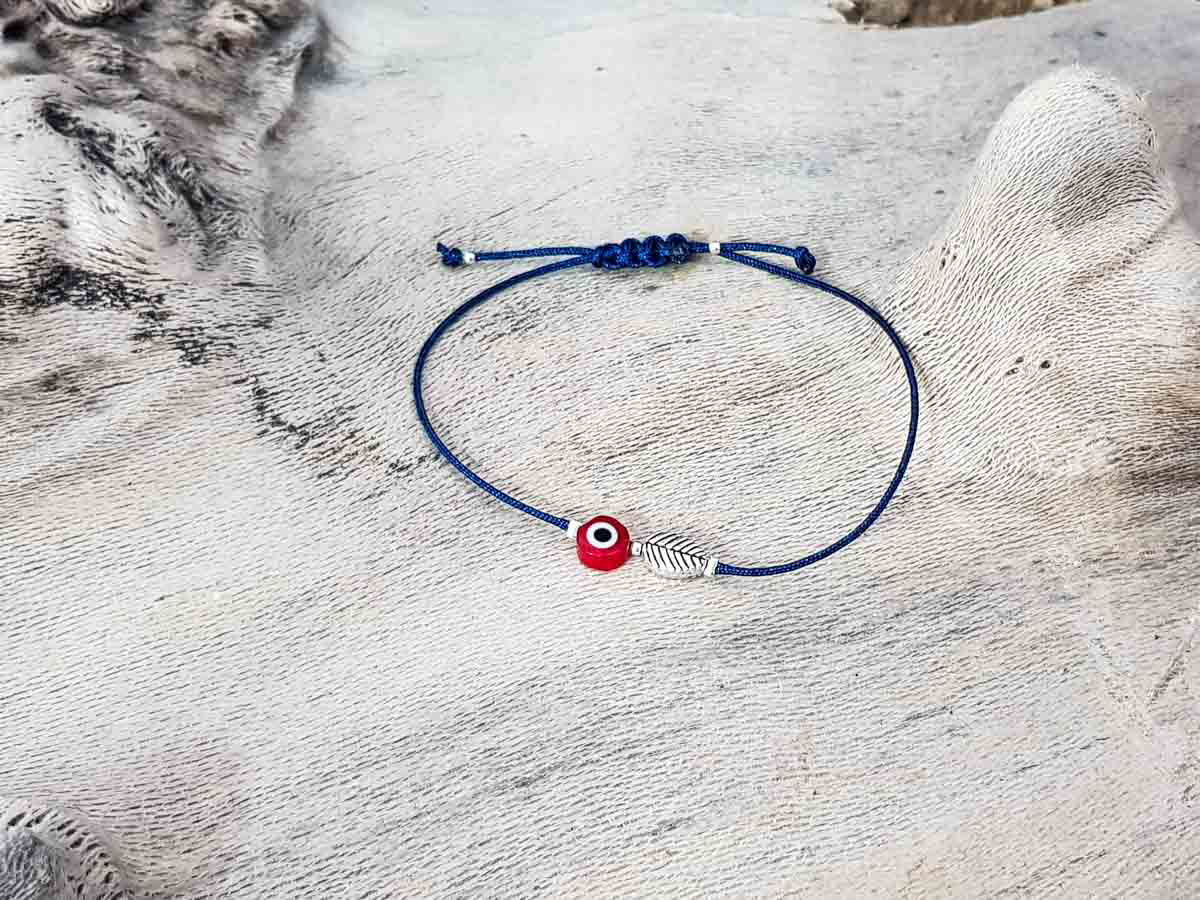 Red Evil Eye Leaf Blue String