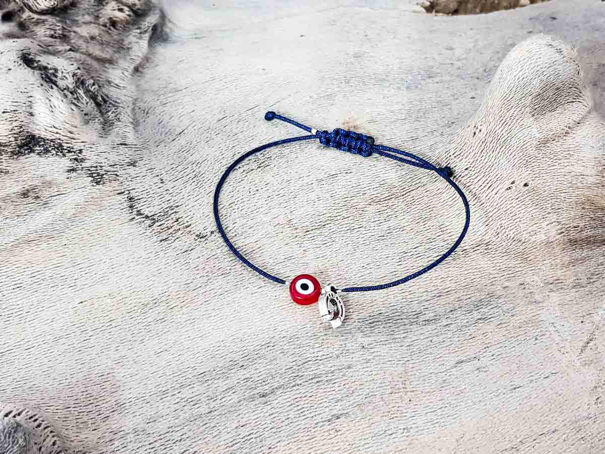 Red Evil Eye Petal Blue String