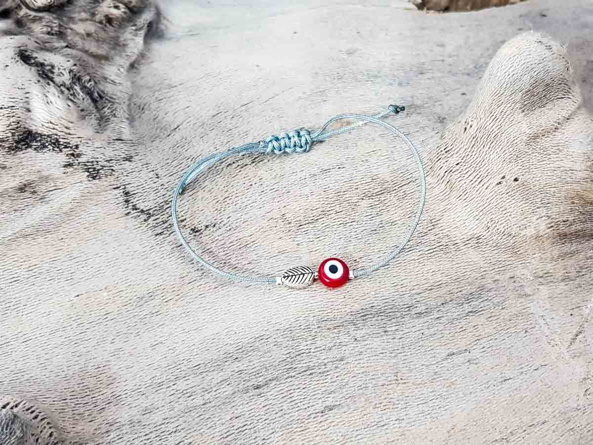 Red Evil Eye Leaf Grey String