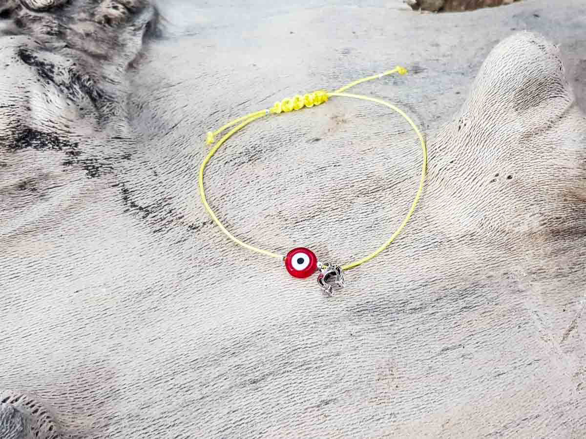 Red Evil Eye Petal Yellow String