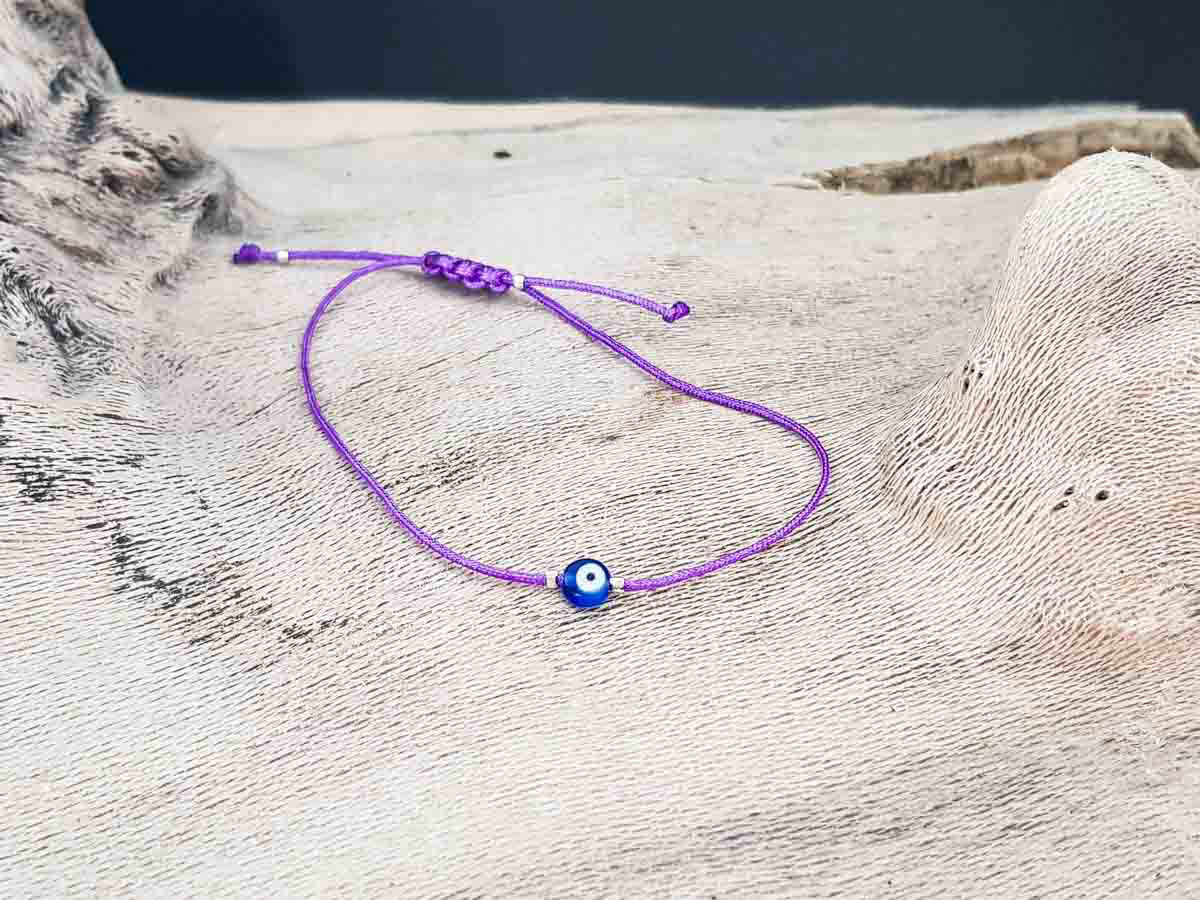 Bracelet small blue evil eye with purple string color