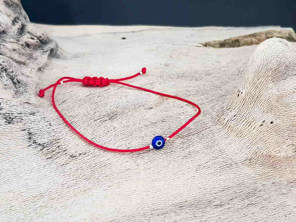 Bracelet small blue evil eye with red string color