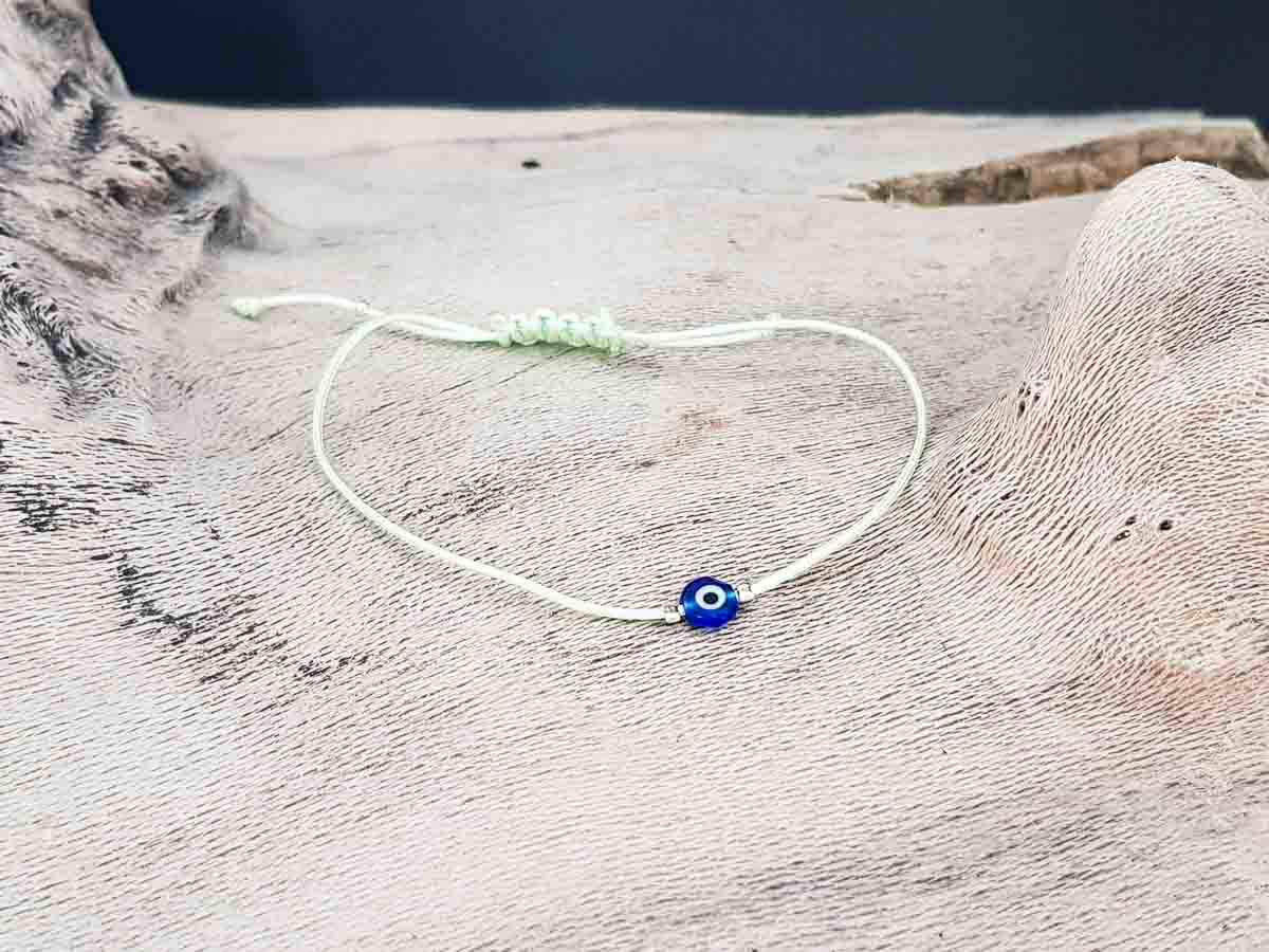 Bracelet small blue evil eye with pixie green string color
