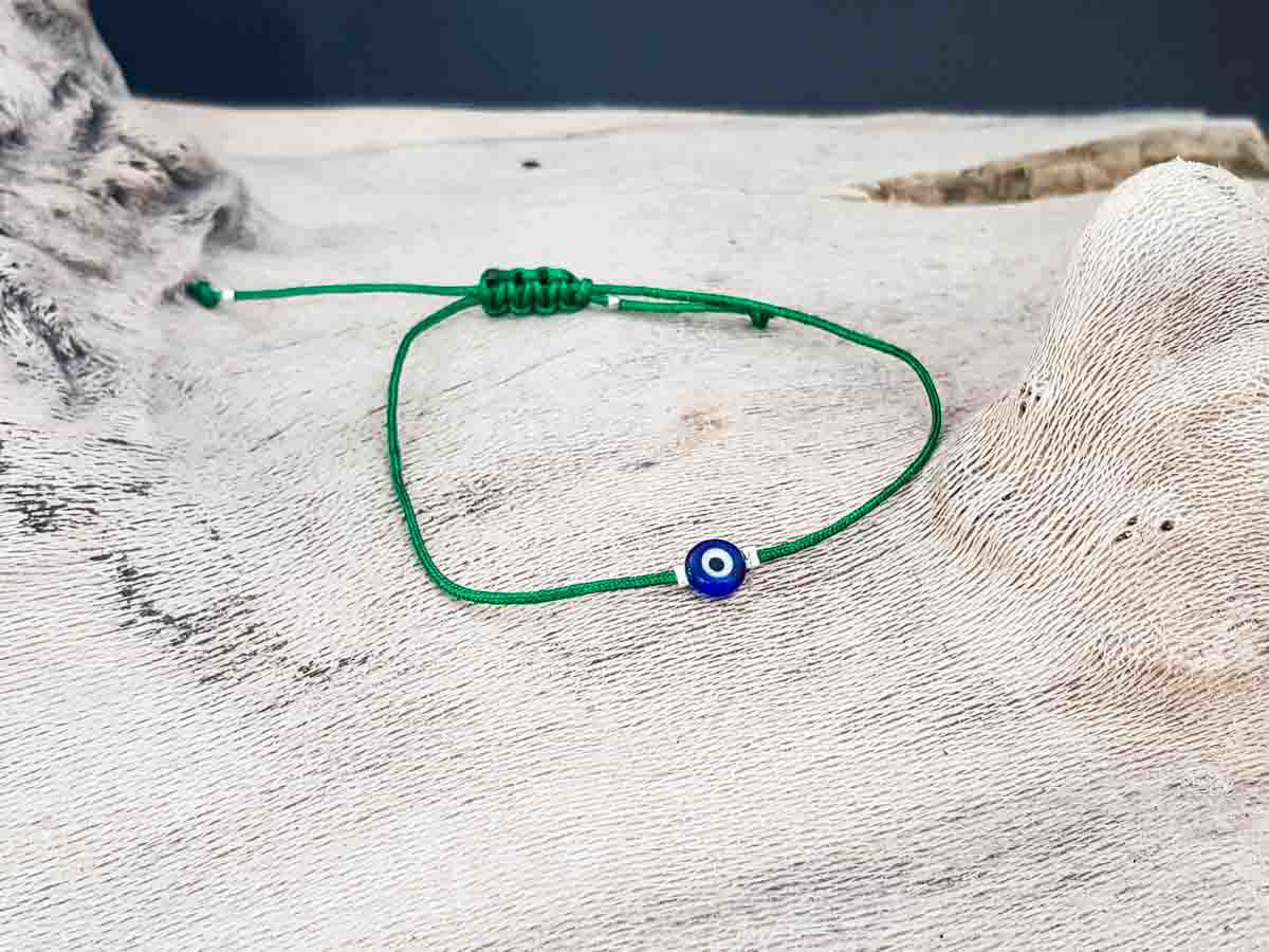 Bracelet small blue evil eye with green string color