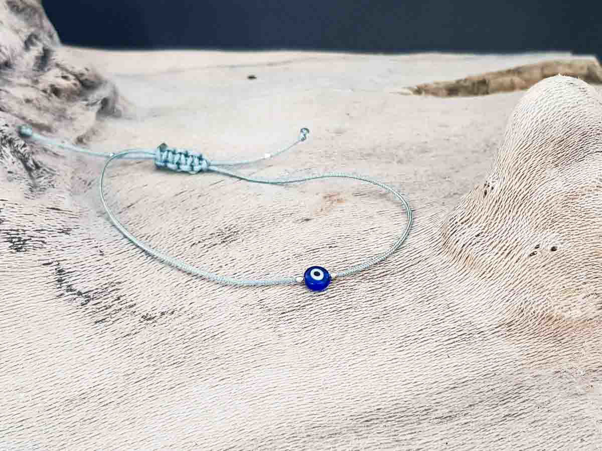 Bracelet small blue evil eye with grey string color
