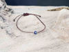 Bracelet small blue evil eye with brown string color