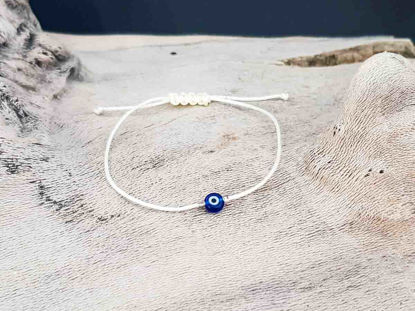 Bracelet small blue evil eye with beige string color