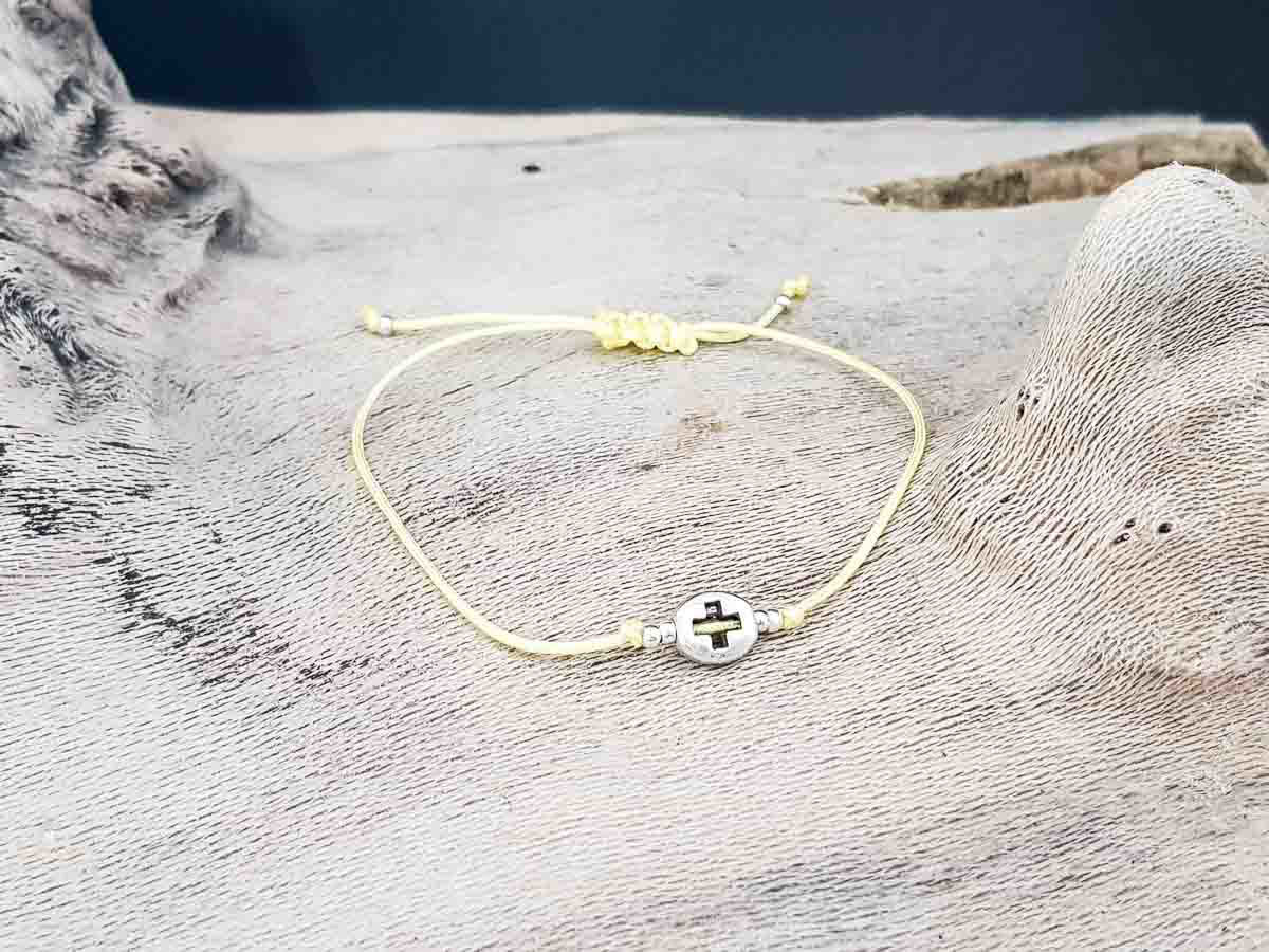 Bracelet small round metallic Cross with yellow string