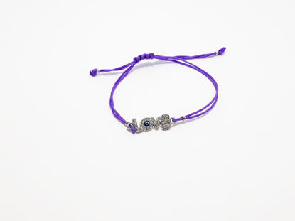 Handmade bracelet with love charm decorated with small transparent crystal beads and a very small evil eye