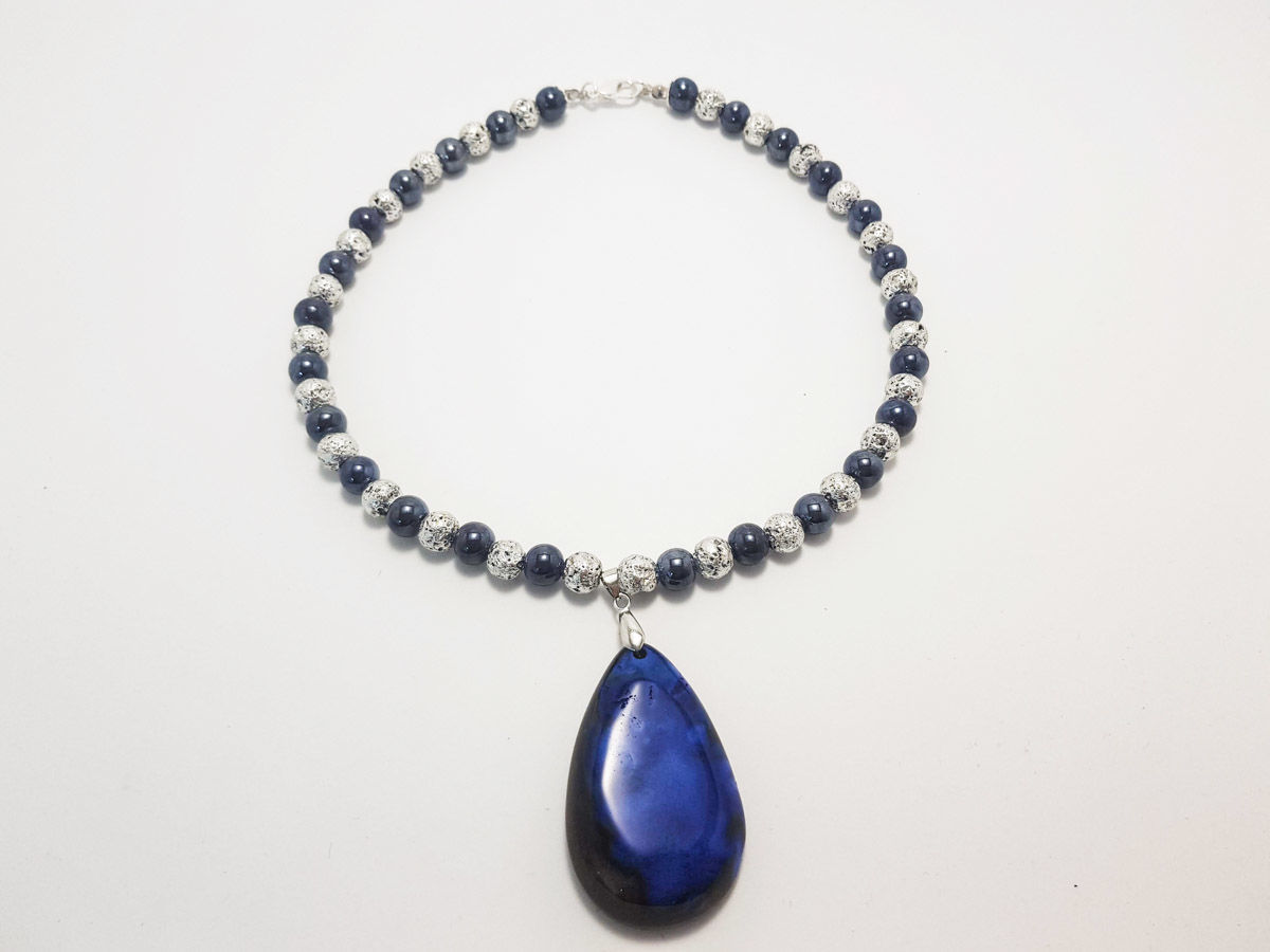 Picture of Necklace with big lapis stone, ceramic and silvered colored lava stones. Handmade
