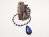 Снимка на Necklace with big lapis stone, ceramic and silvered colored lava stones. Handmade