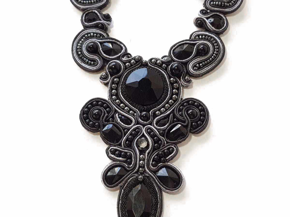 Picture of Soutache Necklace with various size crystal beads. Handmade